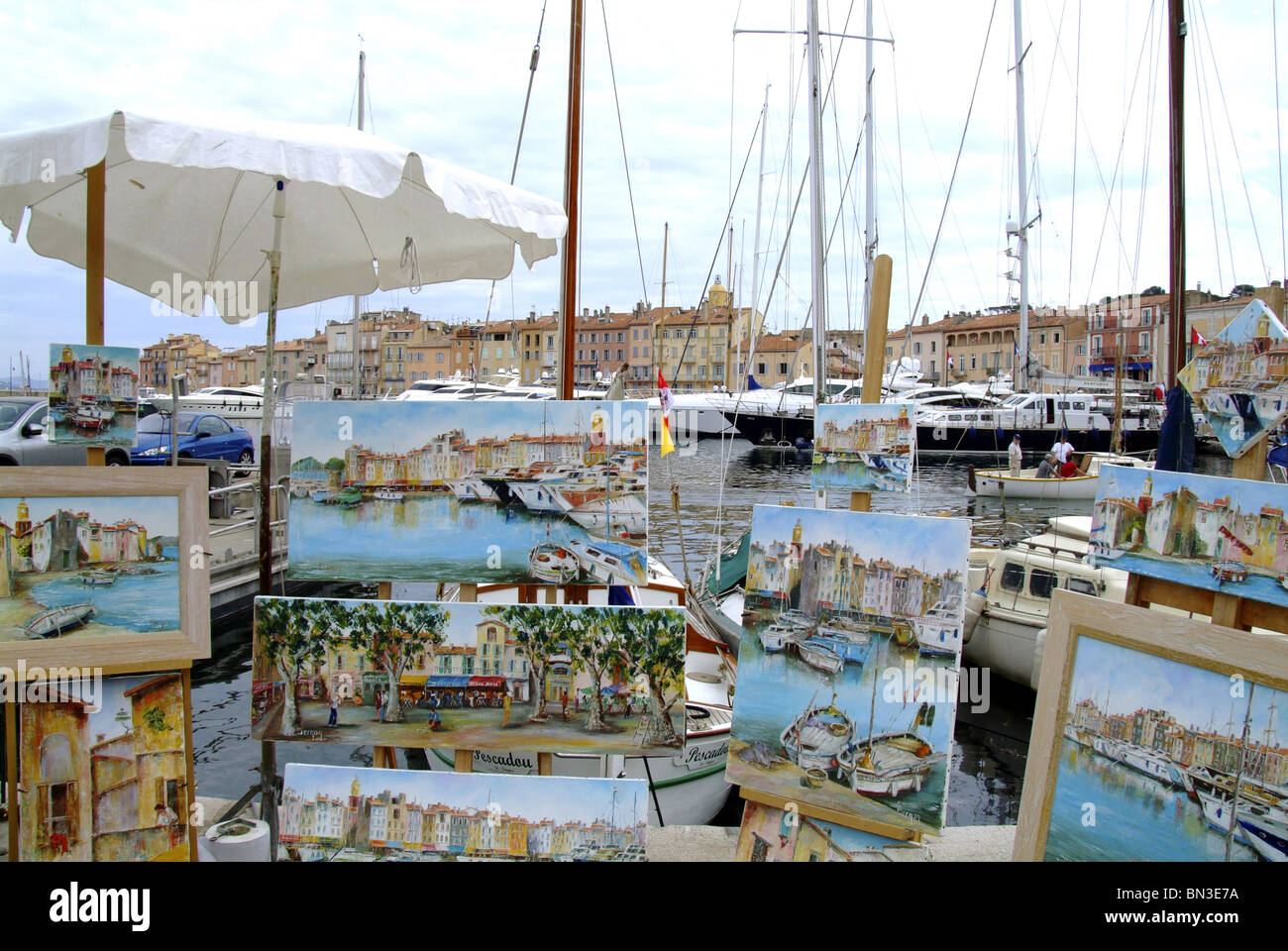 Display of paintings at the harbour of St. Tropez, France Stock Photo
