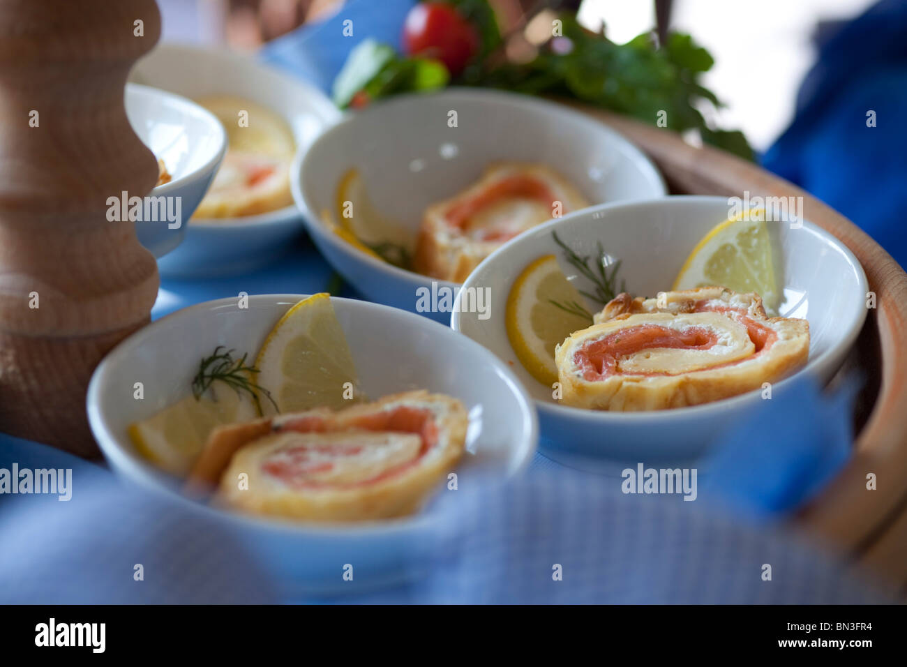 Appetiser with salmon in small bowls, close-up - Stock Image
