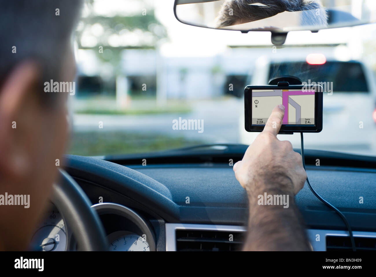 Driver using GPS for navigational assistance - Stock Image