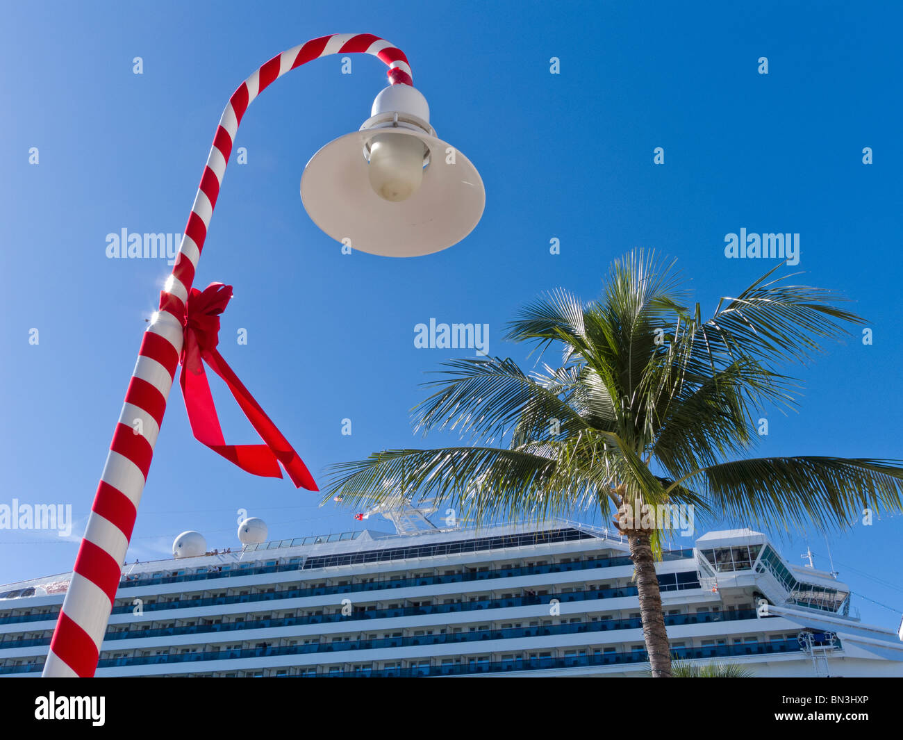 christmas decorations turn street lamp into candy cane at mallory square cruise ship dock key - When Do Cruise Ships Decorated For Christmas