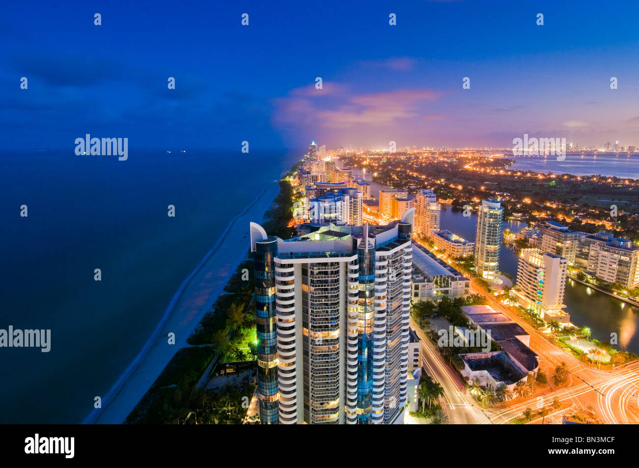 Looking South from high rise, Collins Avenue and Atlantic Ocean at dusk, Miami Beach, Florida, USA - Stock Image