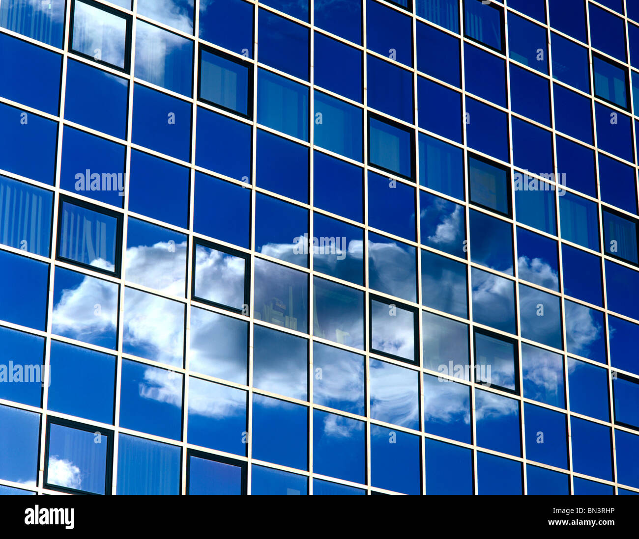 Reflection of clouds on window glasses - Stock Image