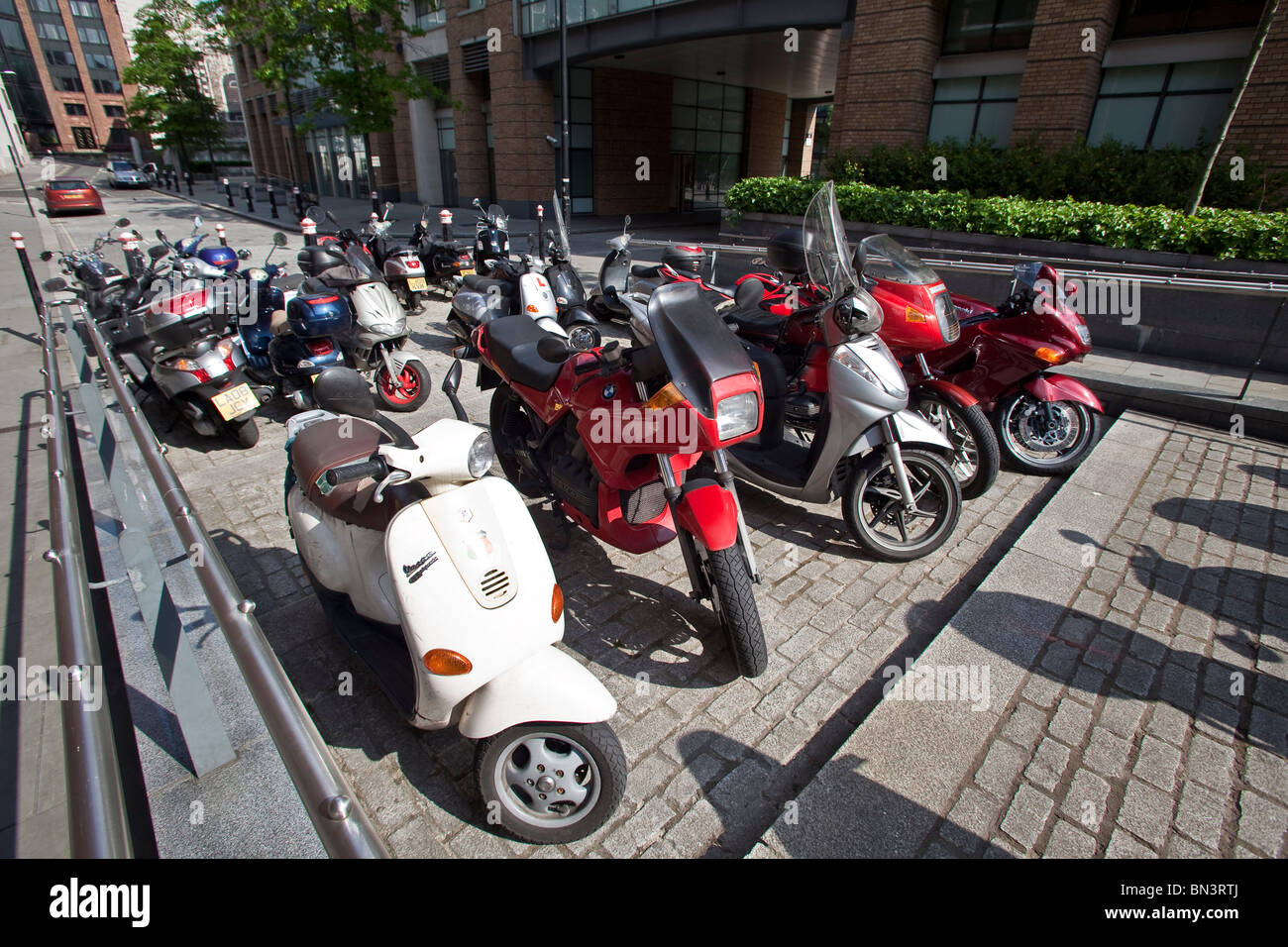 Numerous motorbikes and scooters in the city centre of London - Stock Image