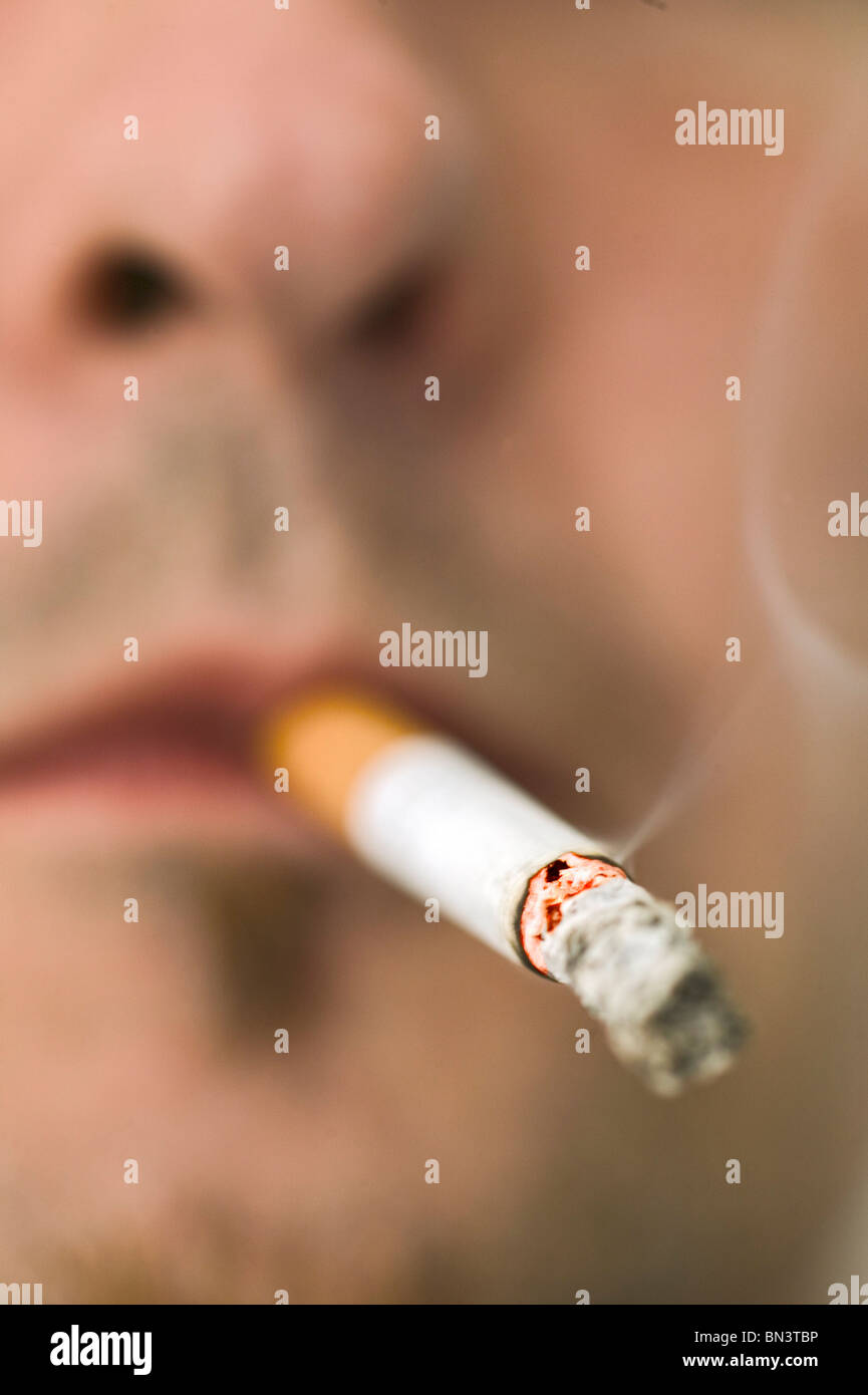 Close-up of man smoking cigarette - Stock Image