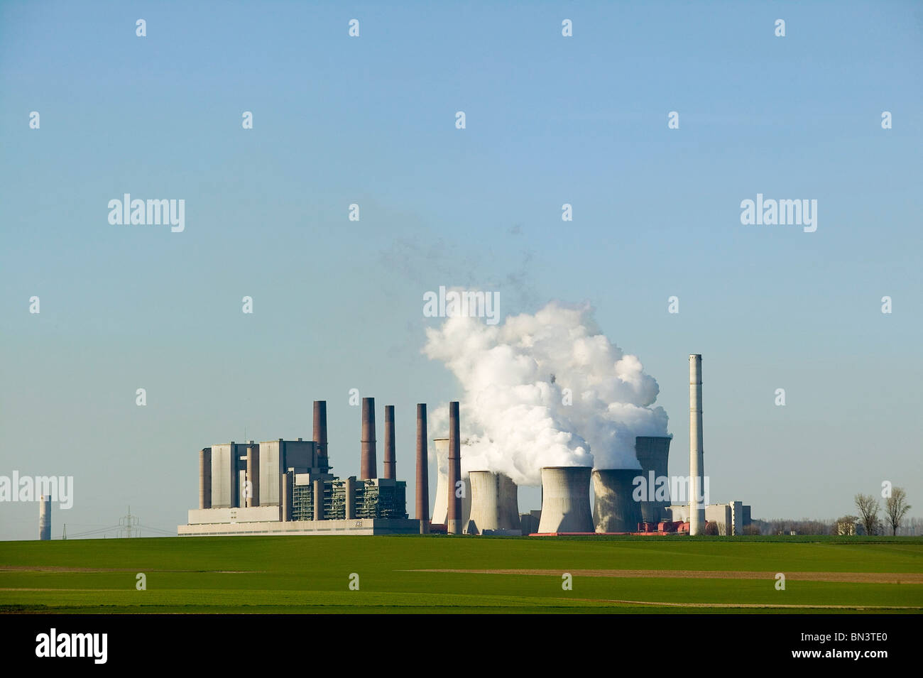 Smoke emitting from smokestacks Stock Photo