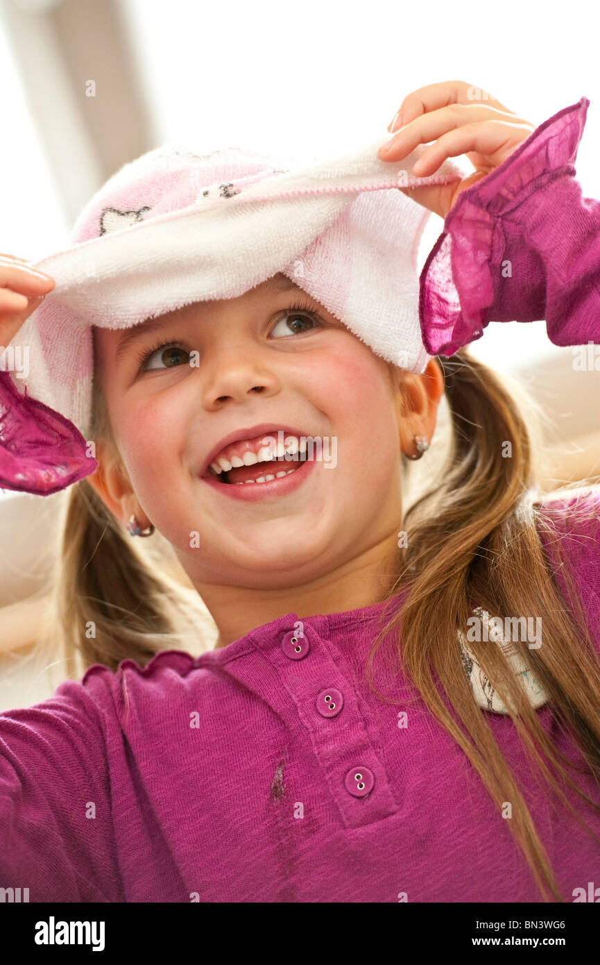 Girl with towel on her head - Stock Image