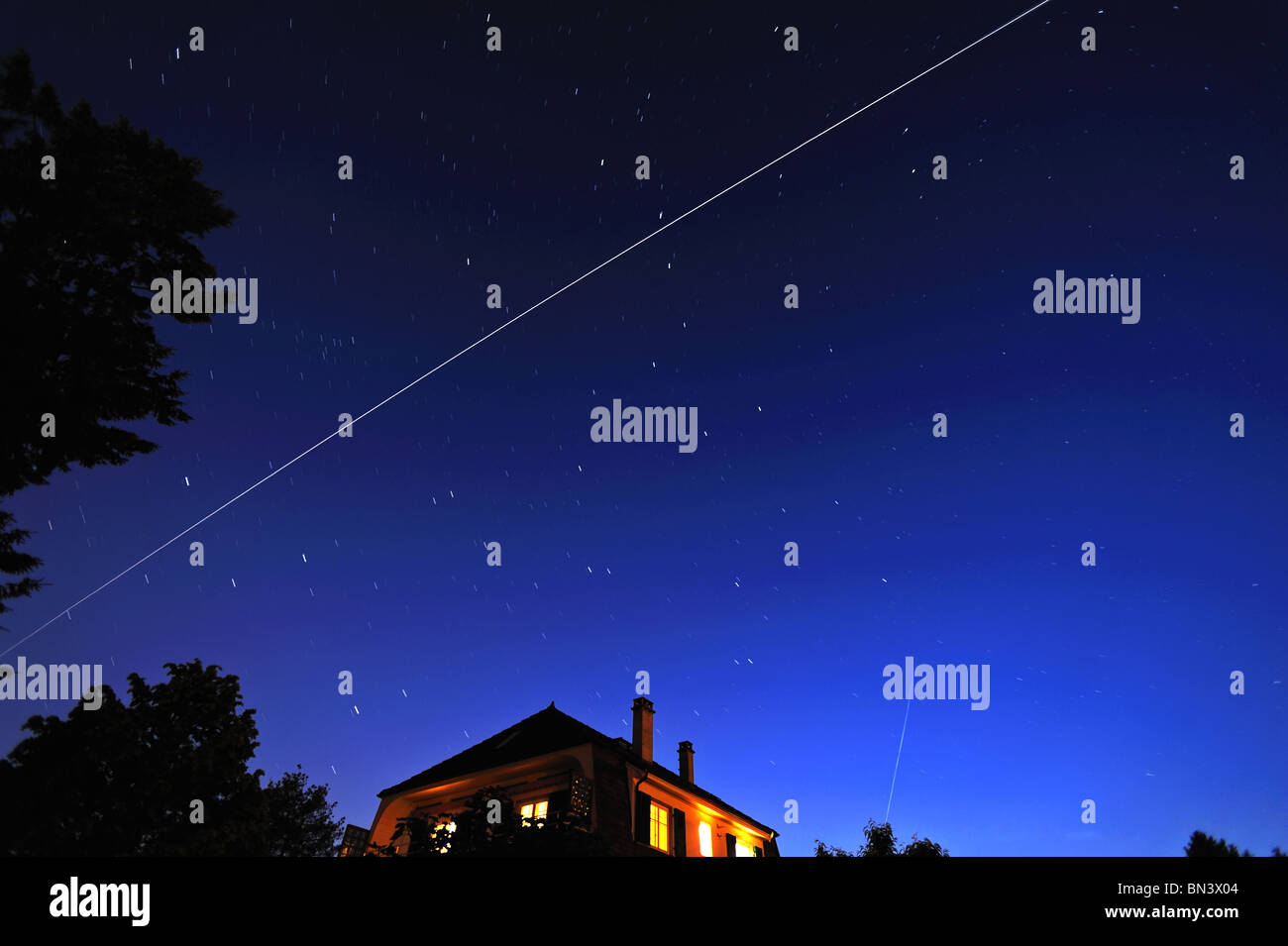 The International Space Station flying through the constellation of the Plough (Ursa major) at dusk. - Stock Image