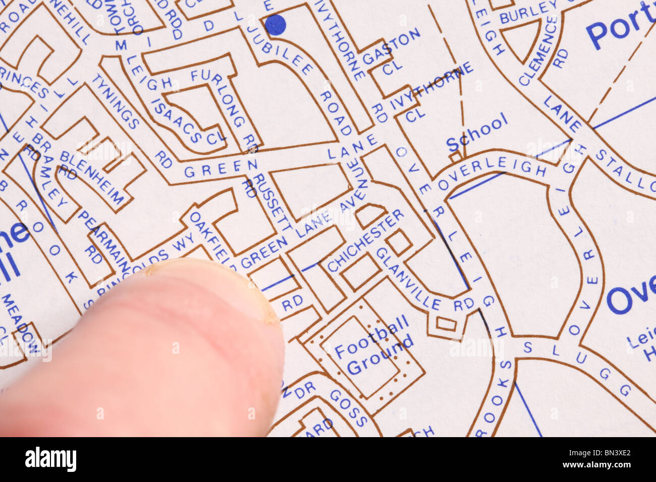 local town road street map with finger pointing location