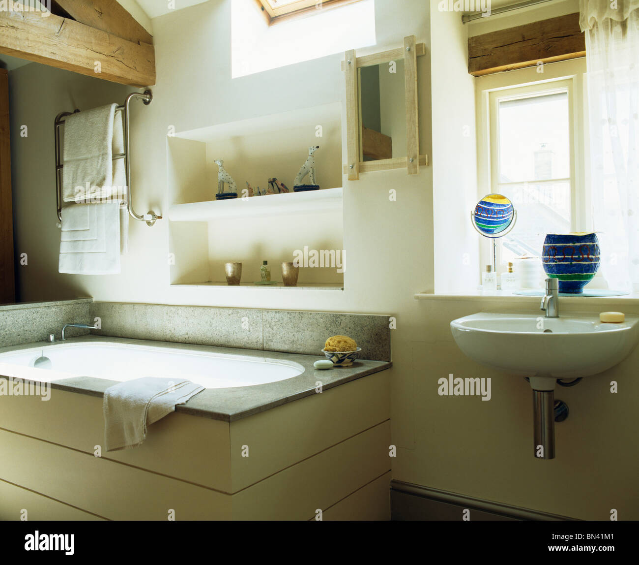 Alcove shelving above bath in modern country bathroom Stock Photo