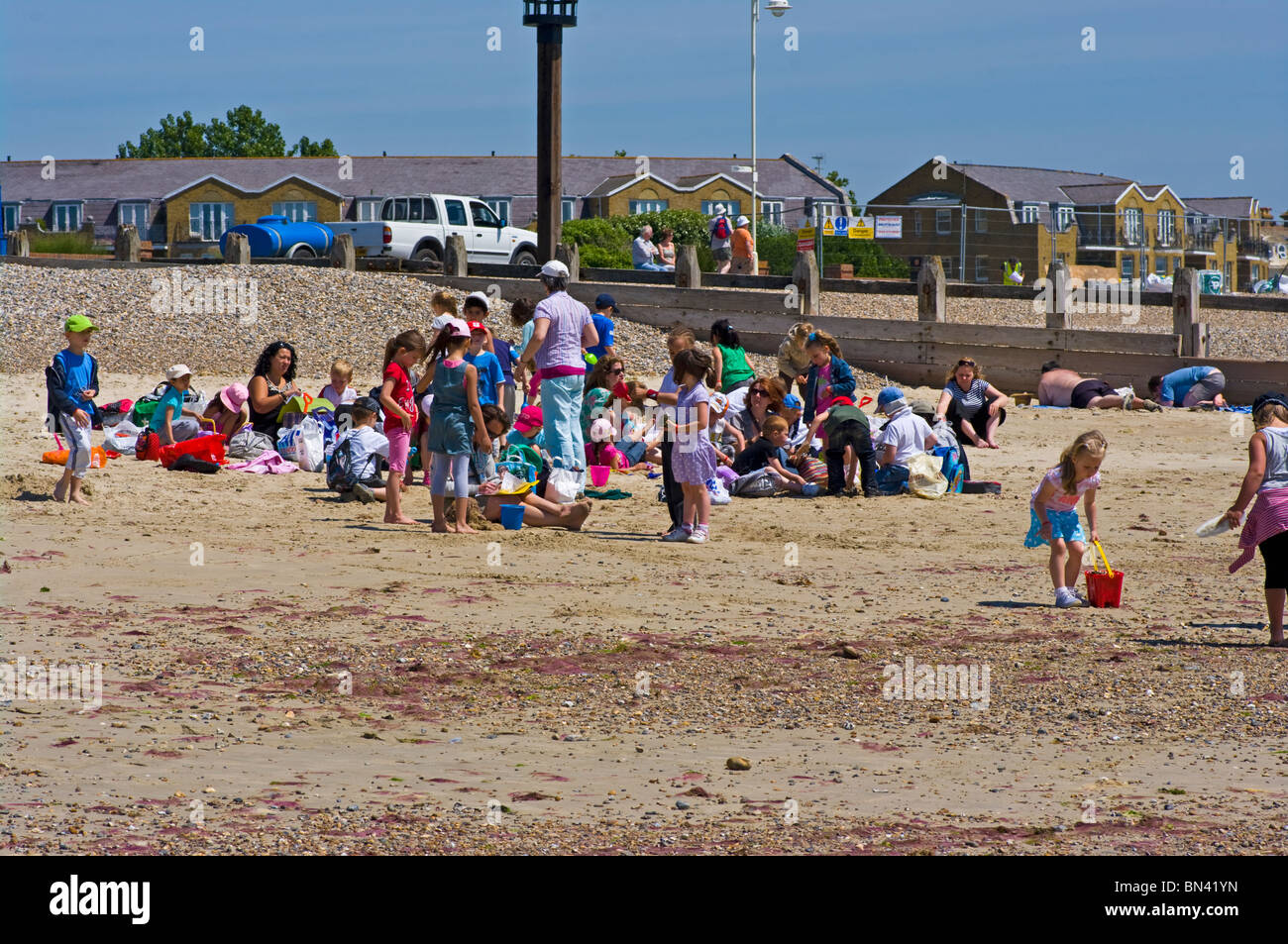 Group Of Young Schoolchildren On The Beach Littlehampton West Sussex England Stock Photo