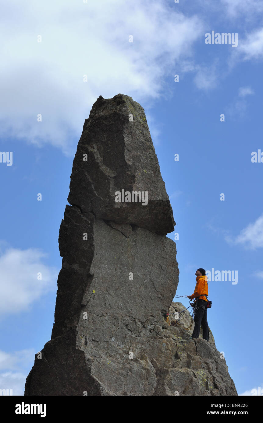 Climber on Napes Needle on Great Gable in the Lake District - Stock Image