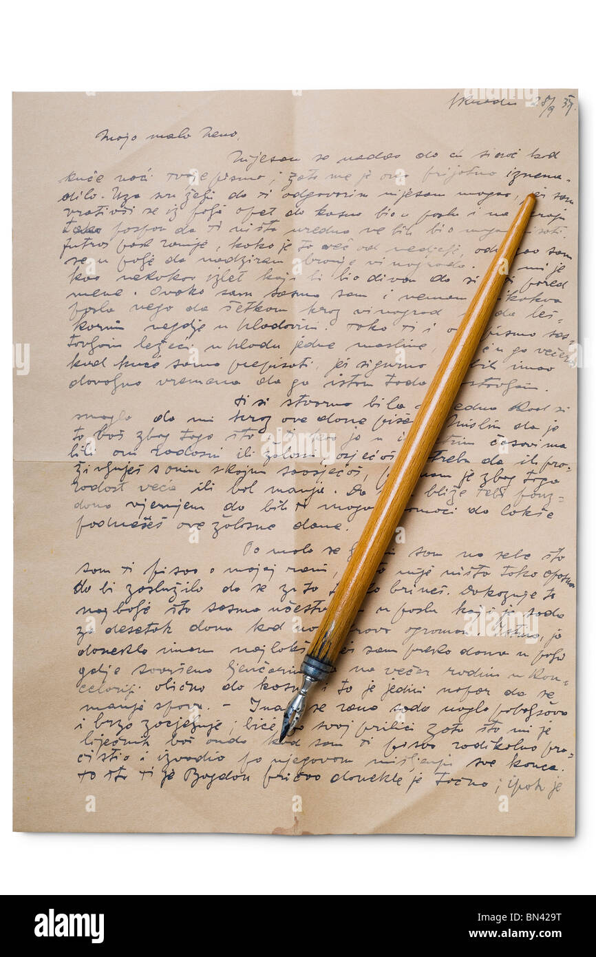 an old pen on a handwritten letter on white - Stock Image