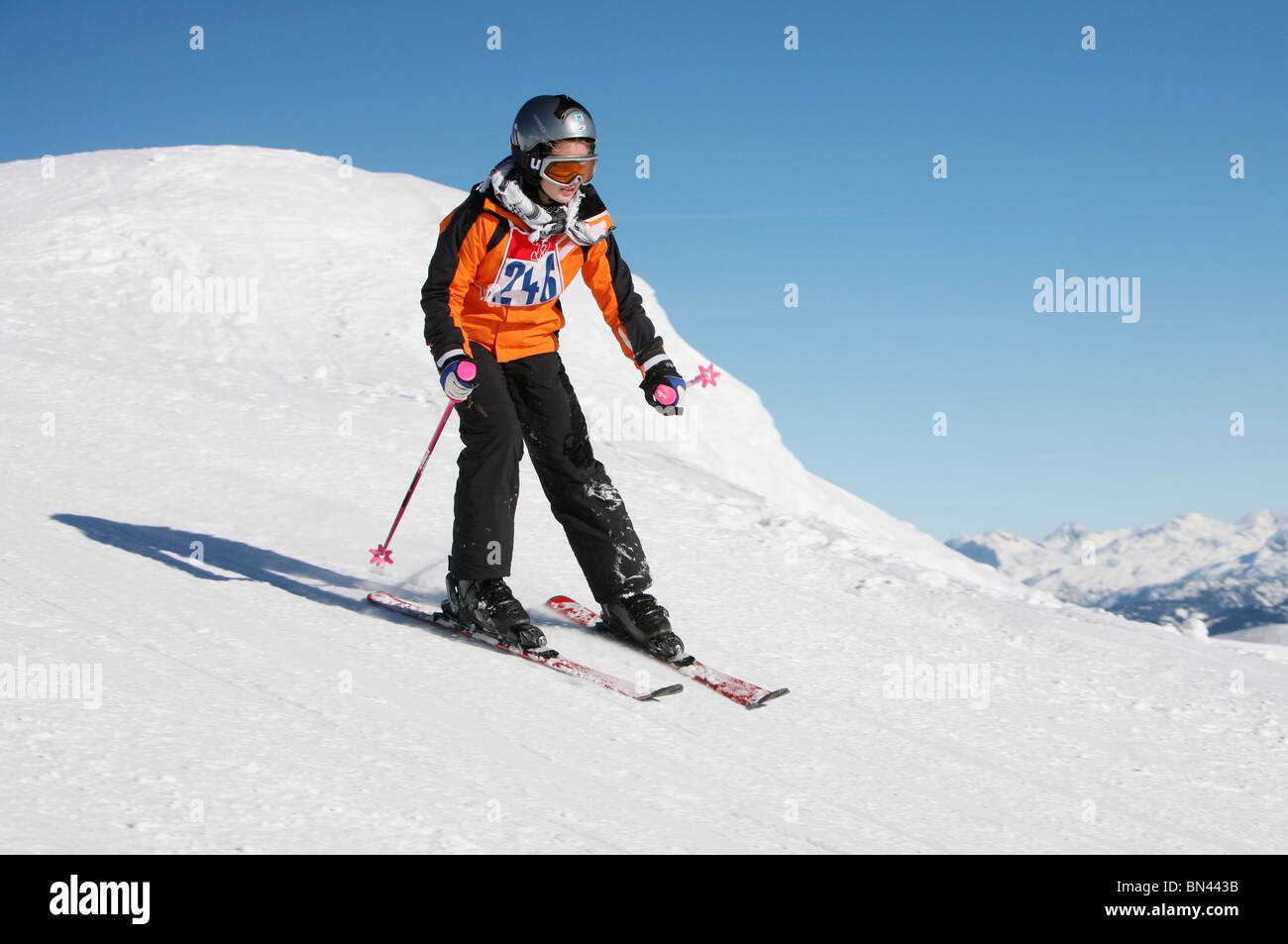 Kid skiing down a slope, Krippenbrunn, Austria - Stock Image