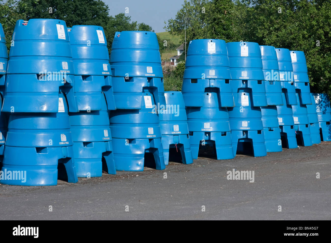 Drinking water storage containers stacked ready for use in case of a