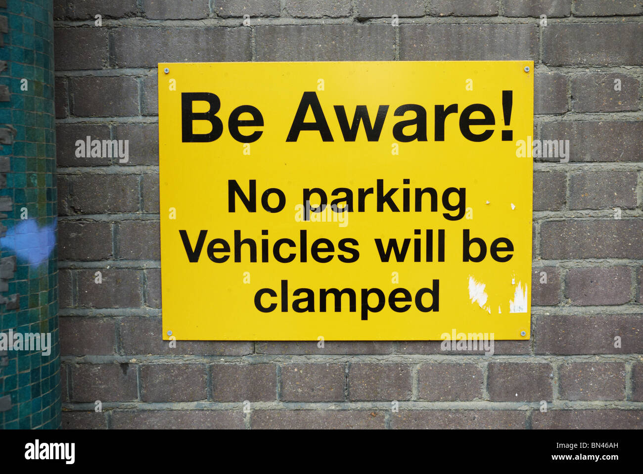 beware vehicle car clamping sign in london england uk - Stock Image