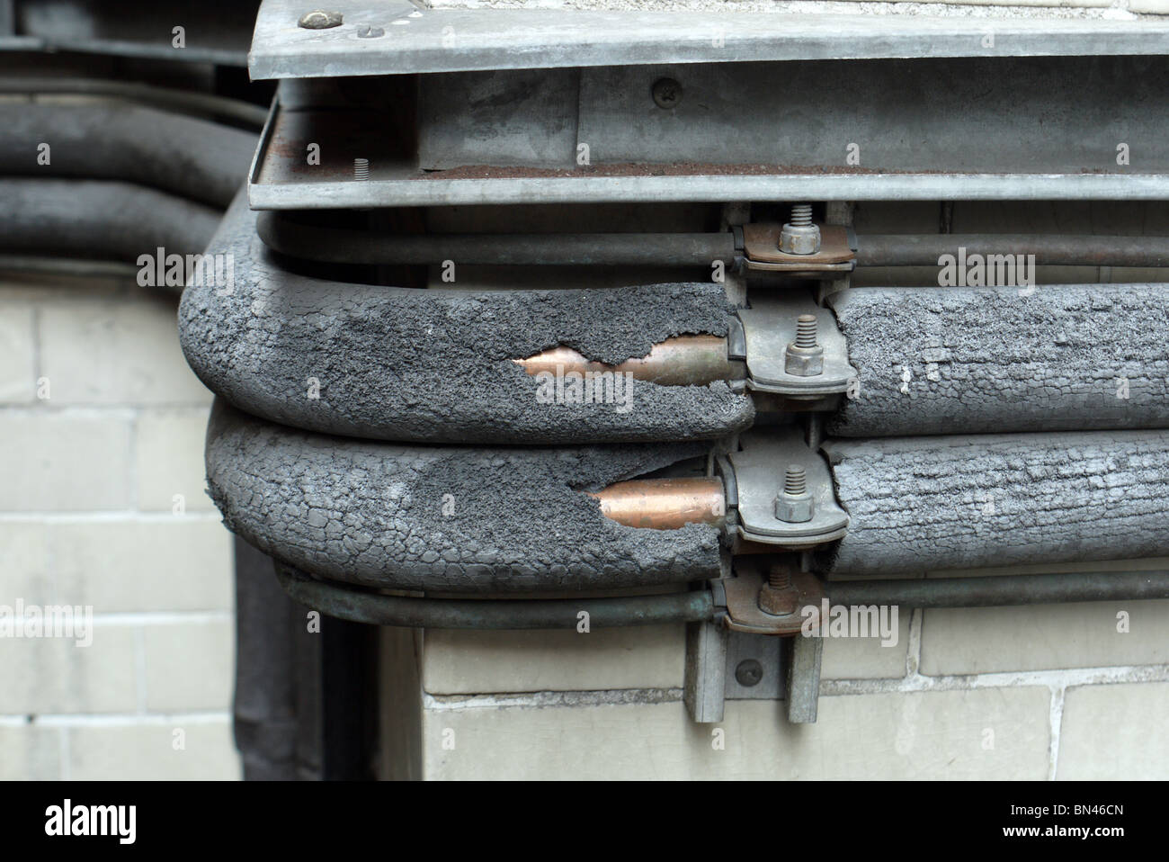corroding pipe insulation in london england uk - Stock Image