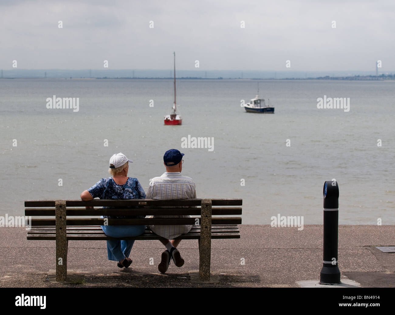 Outstanding Two People Sitting On A Wooden Bench On The Seafront At Bralicious Painted Fabric Chair Ideas Braliciousco