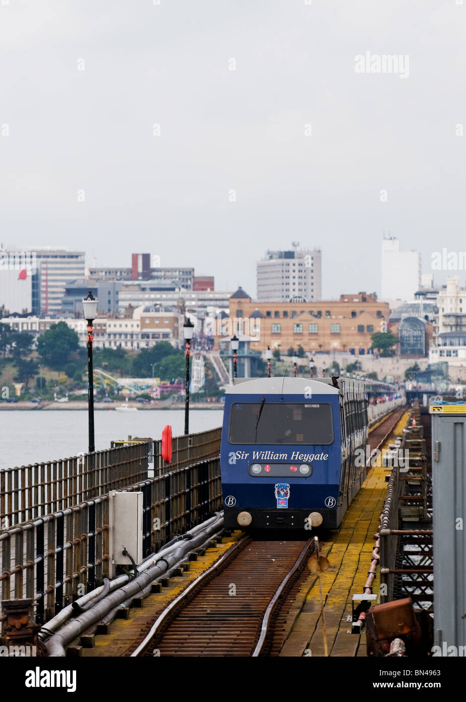 One of the electric trains arriving at the pierhead platform on Southend Pier in Essex. - Stock Image