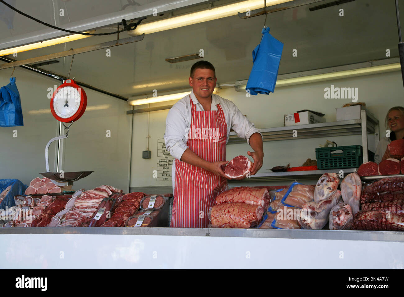 Butcher selling his produce at Dorchester Market - Stock Image