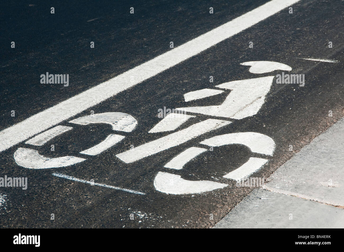 A bike lane is indicated by painted markings on a city street. - Stock Image