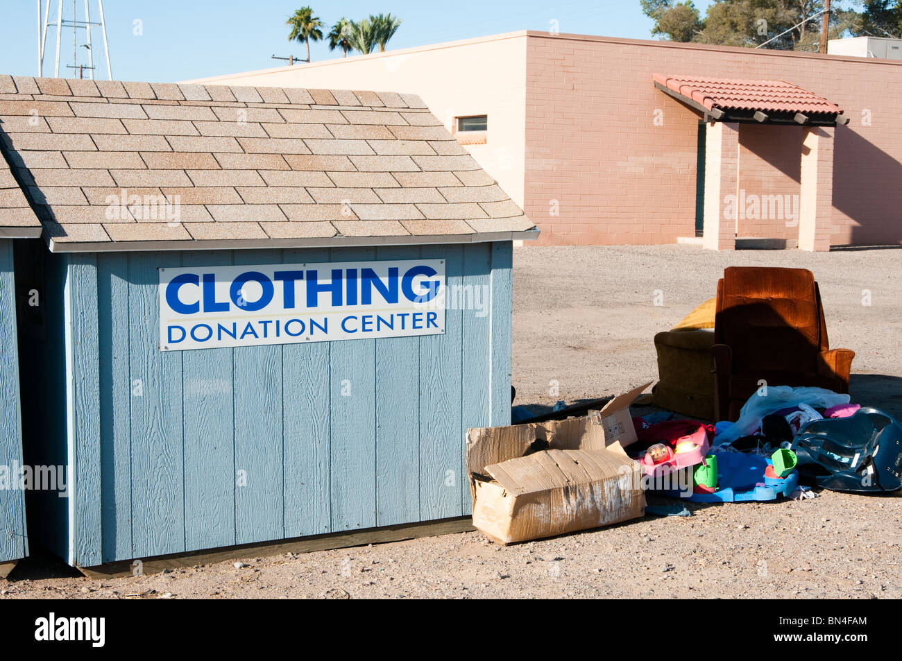 Donation box located where the public can recycle their unwanted clothing. - Stock Image