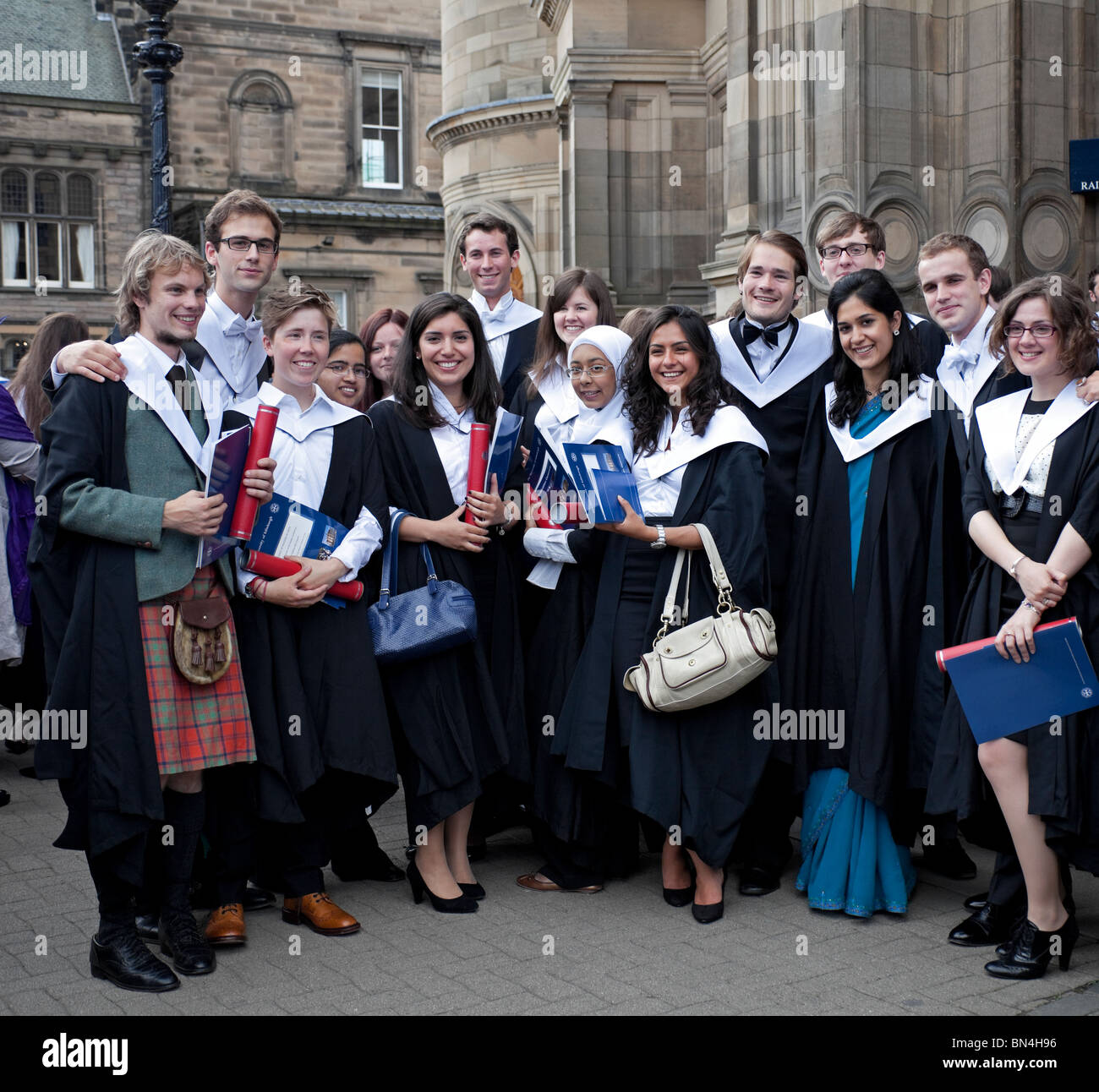 Group of multicultural female and male students graduating from Edinburgh University, Scotland, UK, Europe - Stock Image