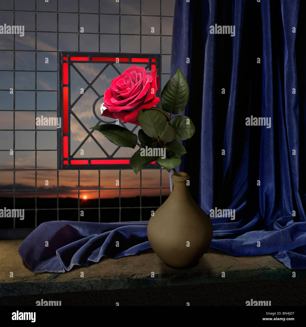 red rose and blue curtain on a window seal with sunset - Stock Image