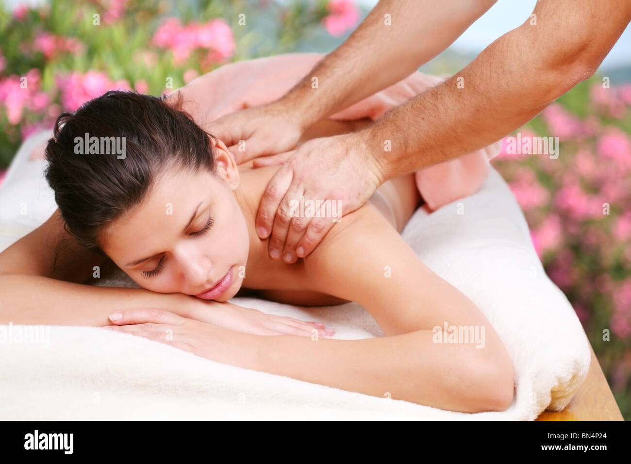 Young woman gets a massage. - Stock Image