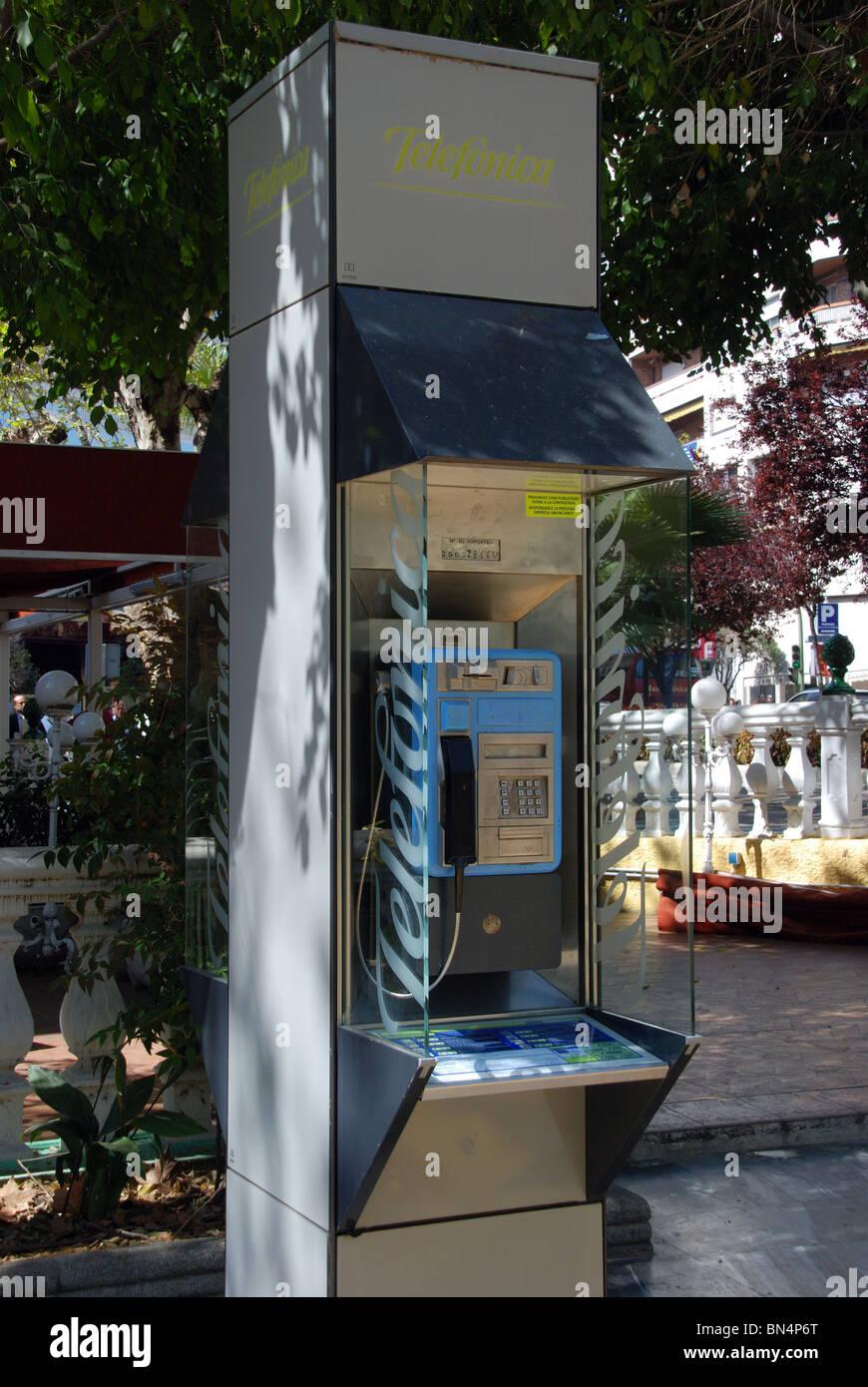 Public telephone kiosk, Marbella, Costa del Sol, Malaga Province, Andalucia, Spain, Western Europe. - Stock Image