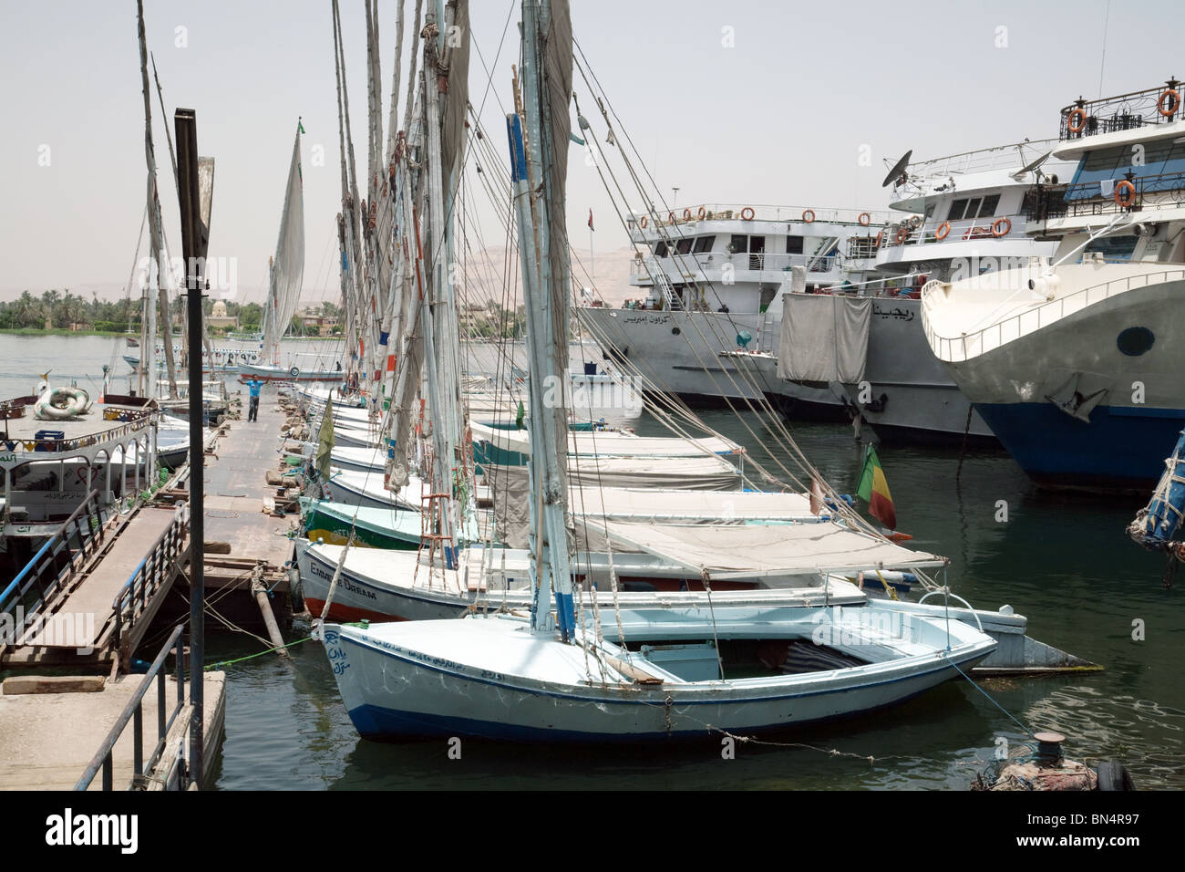 Feluccas moored on the river Nile at Aswan, Upper Egypt - Stock Image