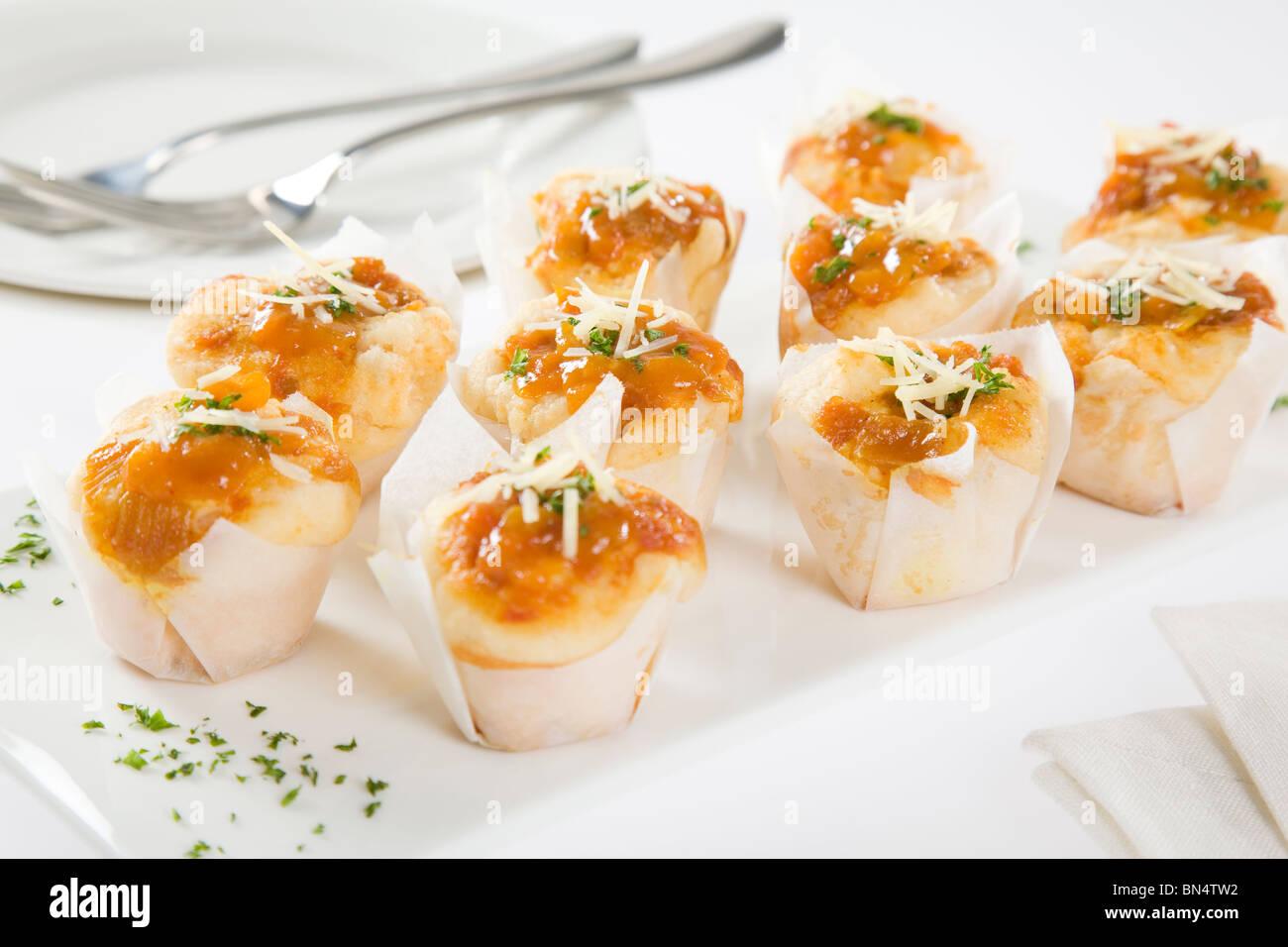 CHEESE & TOMATO RELISH MINI MUFFINS - Stock Image