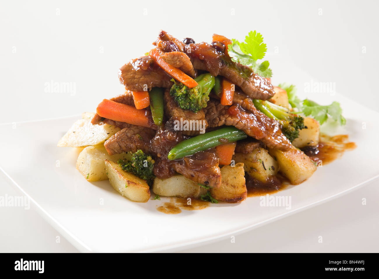 Beef Stir Fry with potatoes - Stock Image