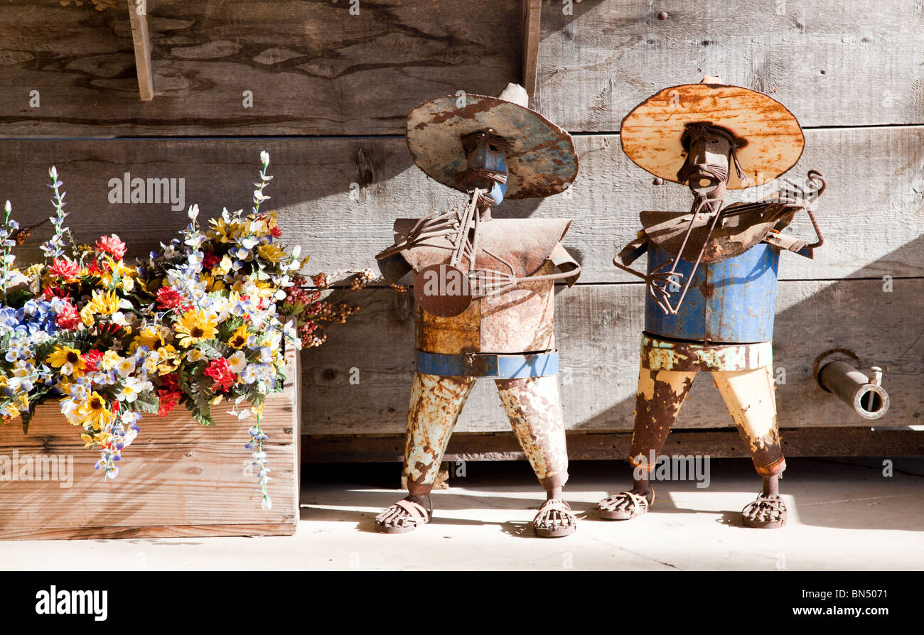 Decorative hand crafted Mexican mariachi band statues made from scrap metal - Stock Image