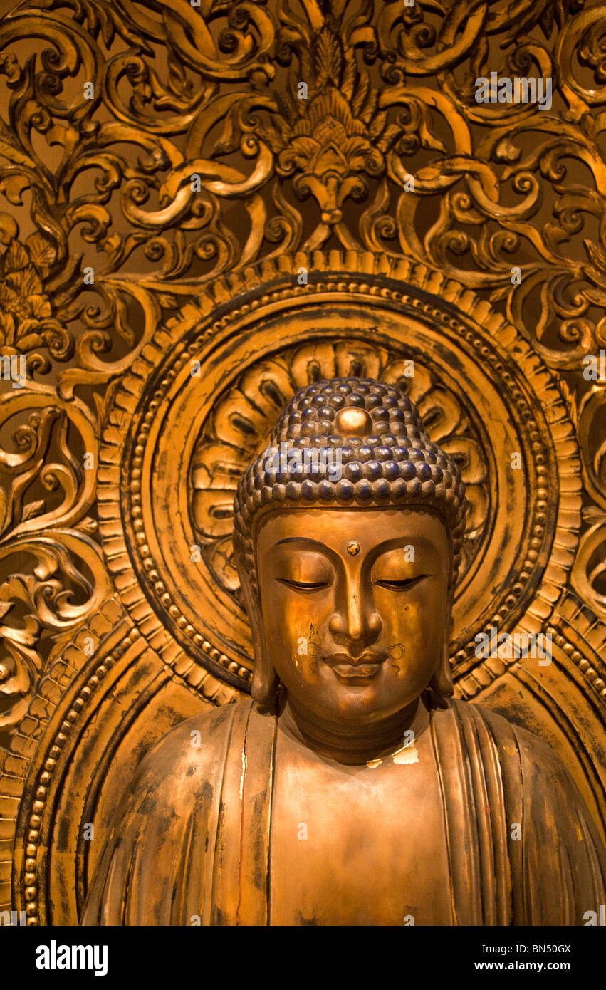 An intricate gilded Buddha statue at the Buddha Tooth Relic Temple in Singapore - Stock Image