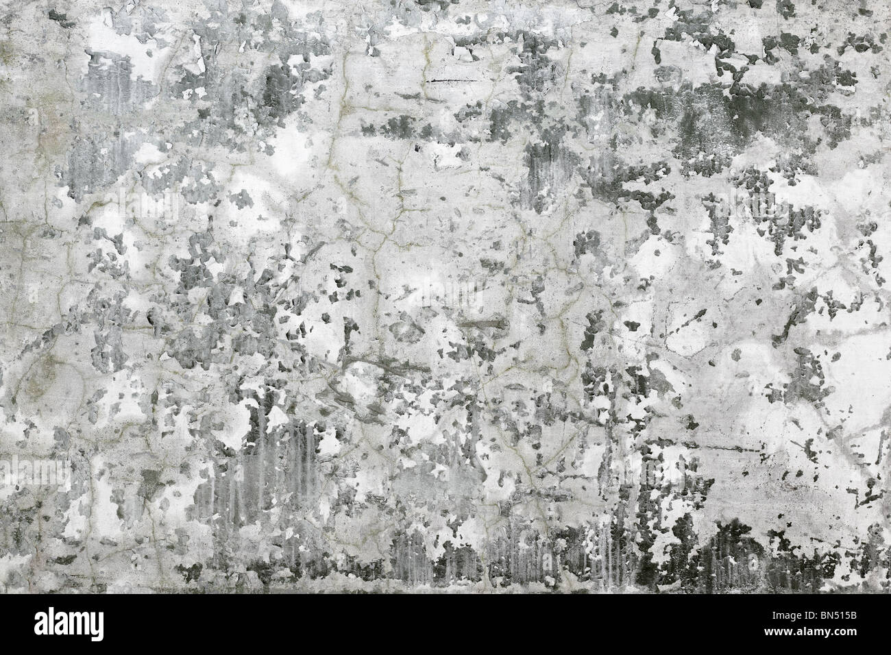 The gray concrete wall covered with stains and cracks - background - Stock Image