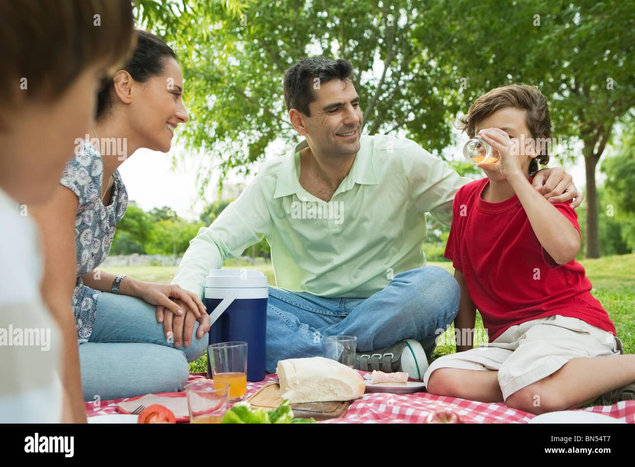 Family enjoying picnic outdoors - Stock Image