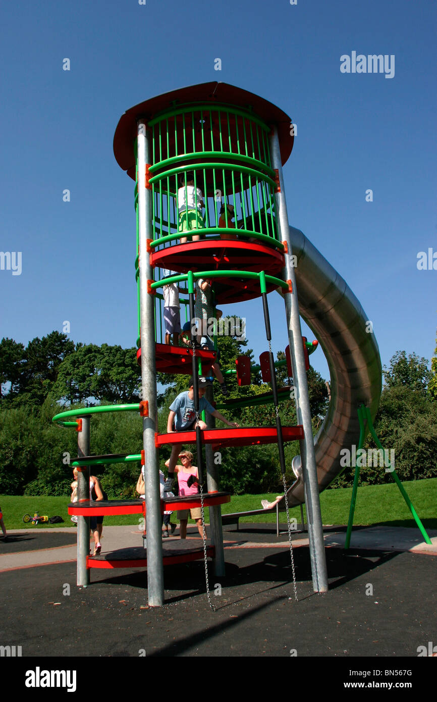 England, Cheshire, Stockport, Cheadle, Bruntwood Park, award-winning children's play area, children on curved - Stock Image