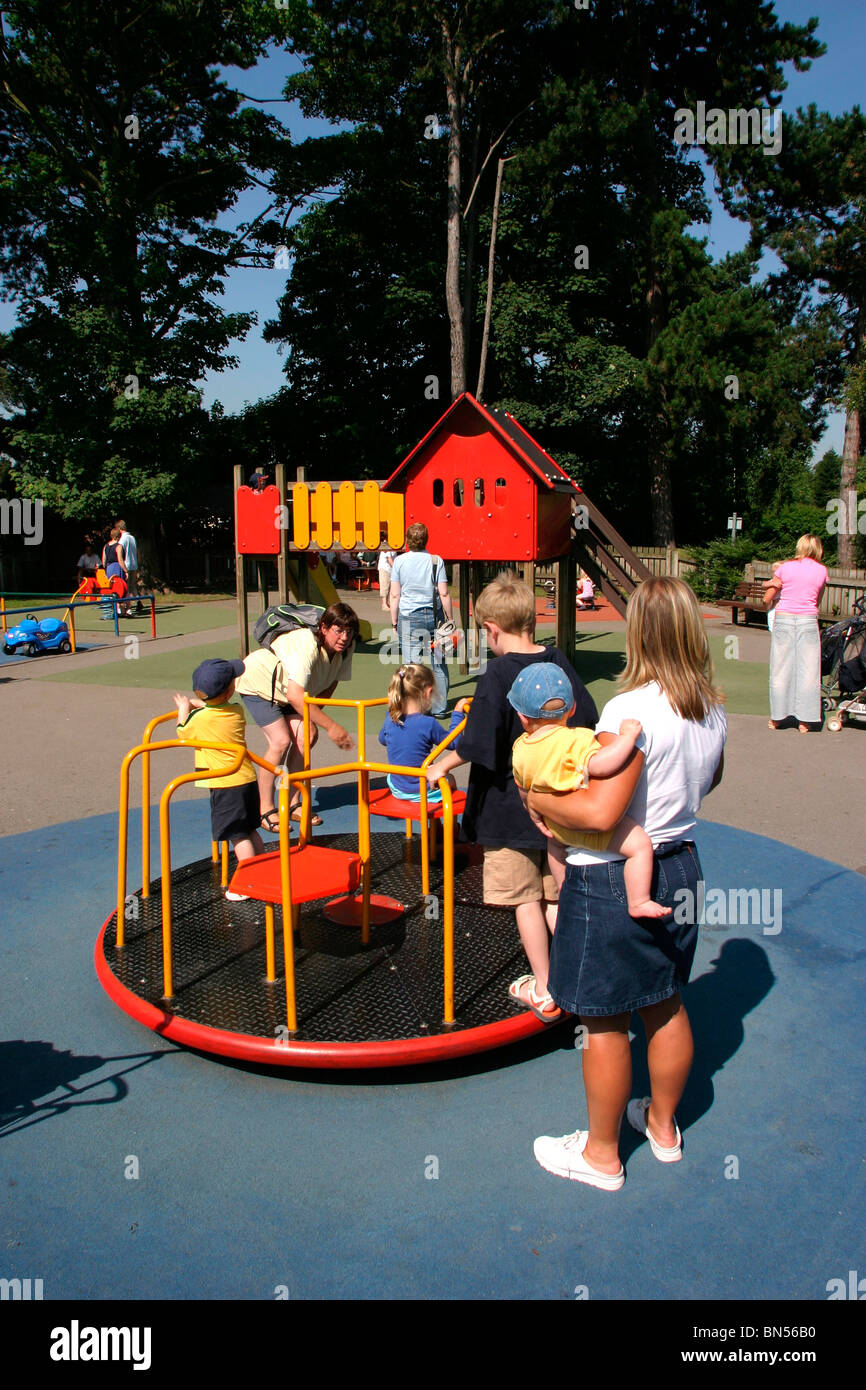 England, Cheshire, Stockport, Cheadle, Bruntwood Park, award-winning children's play area, children playing - Stock Image