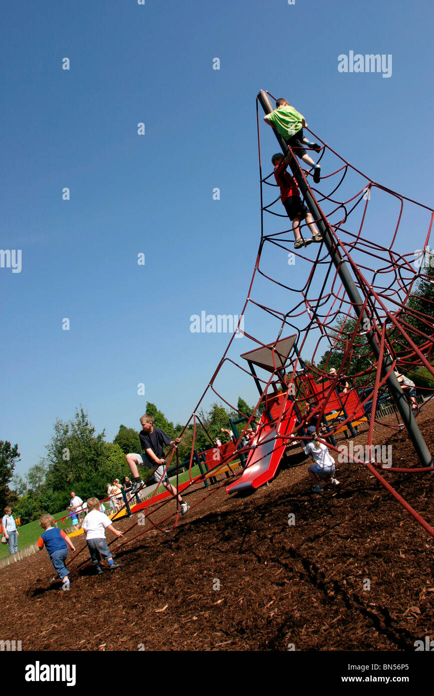 England, Cheshire, Stockport, Cheadle, Bruntwood Park, award-winning children's play area playing on climbing - Stock Image