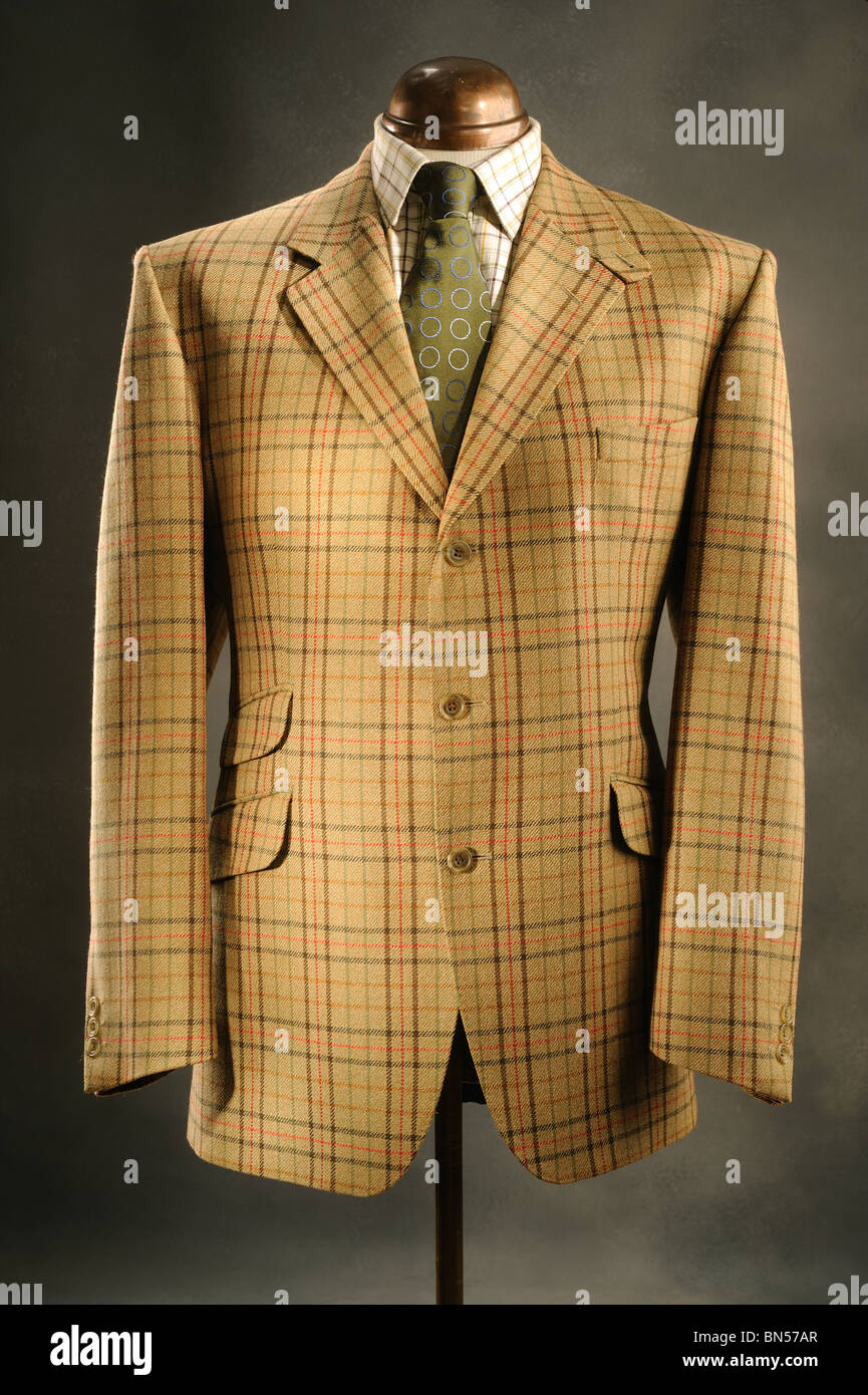 Traditional gentlemens  Woollen Tweed check Jacket with  tattersall shirt on Tailors Dummy. - Stock Image
