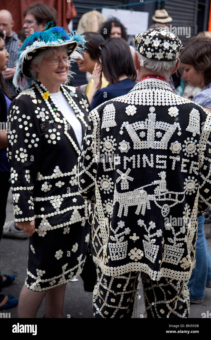 Pearly Kings and Queens in the East End of London. They are an organised charitable tradition of working class culture - Stock Image