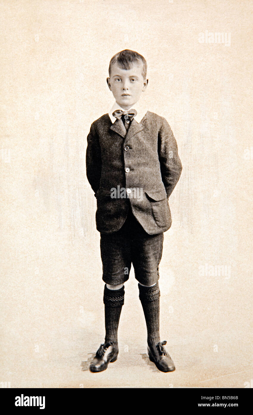 family history formal portrait of boy dating from 1920s wearing short trousers and long socks - Stock Image