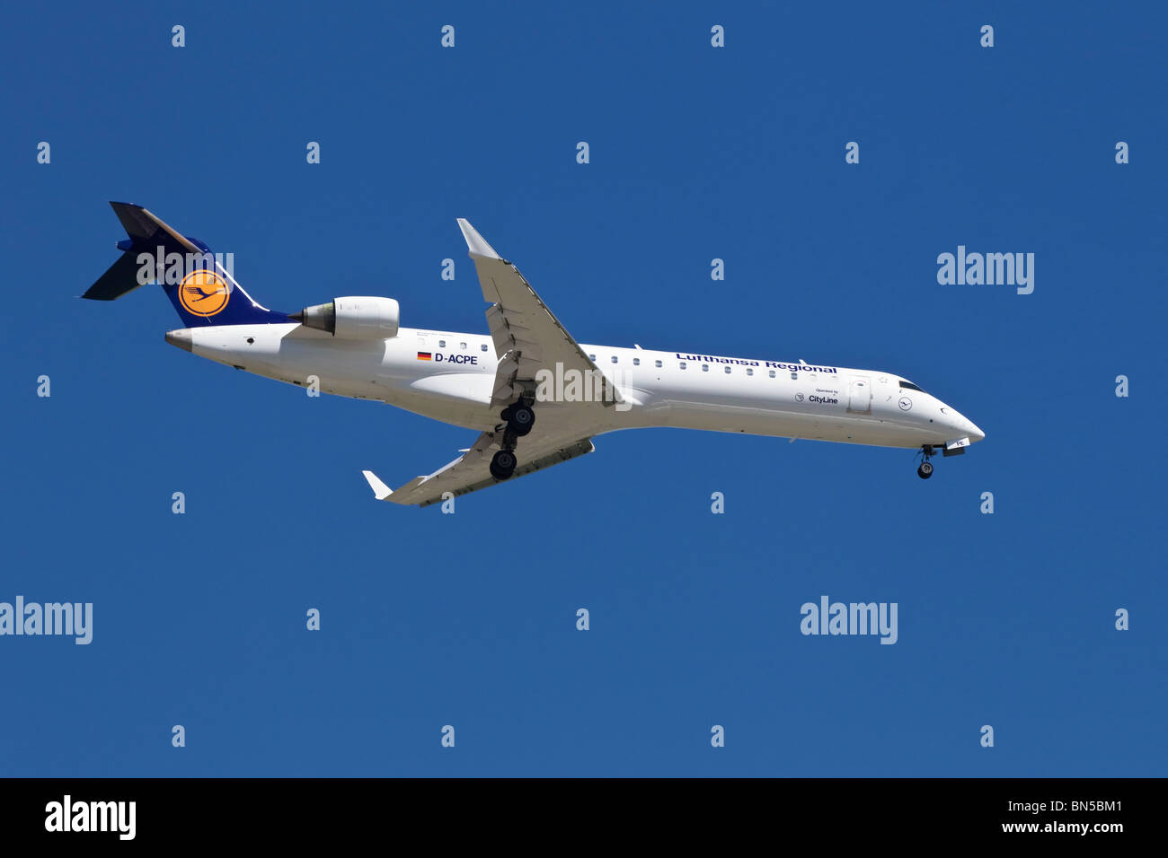 A Bombardier CRJ700 of the German airline Lufthansa - Stock Image