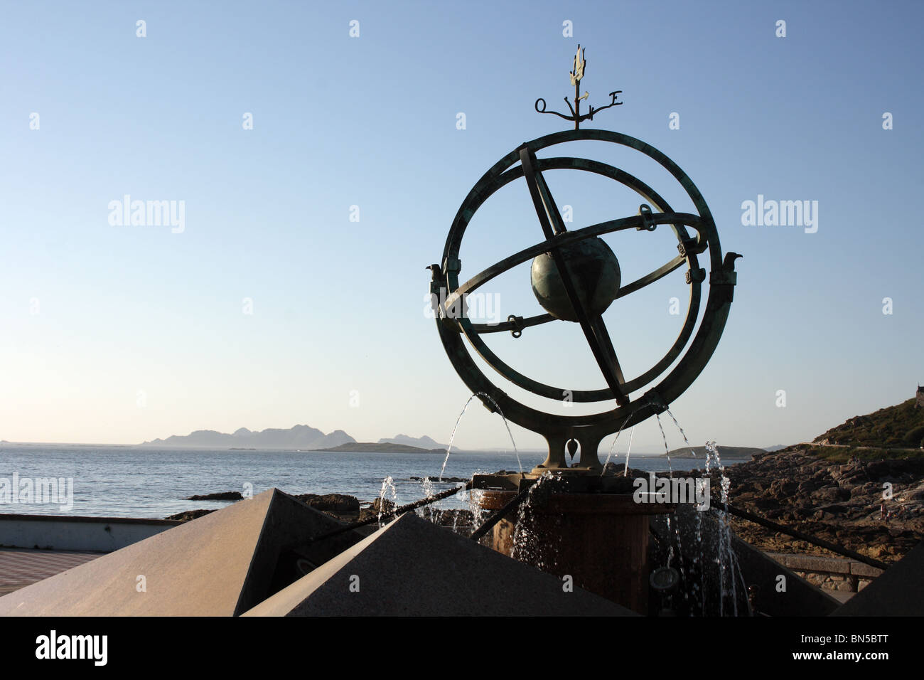 Globe sculpture fountain and view to Islas Cies, Baiona, Bayona, Galicia, Spain - Stock Image