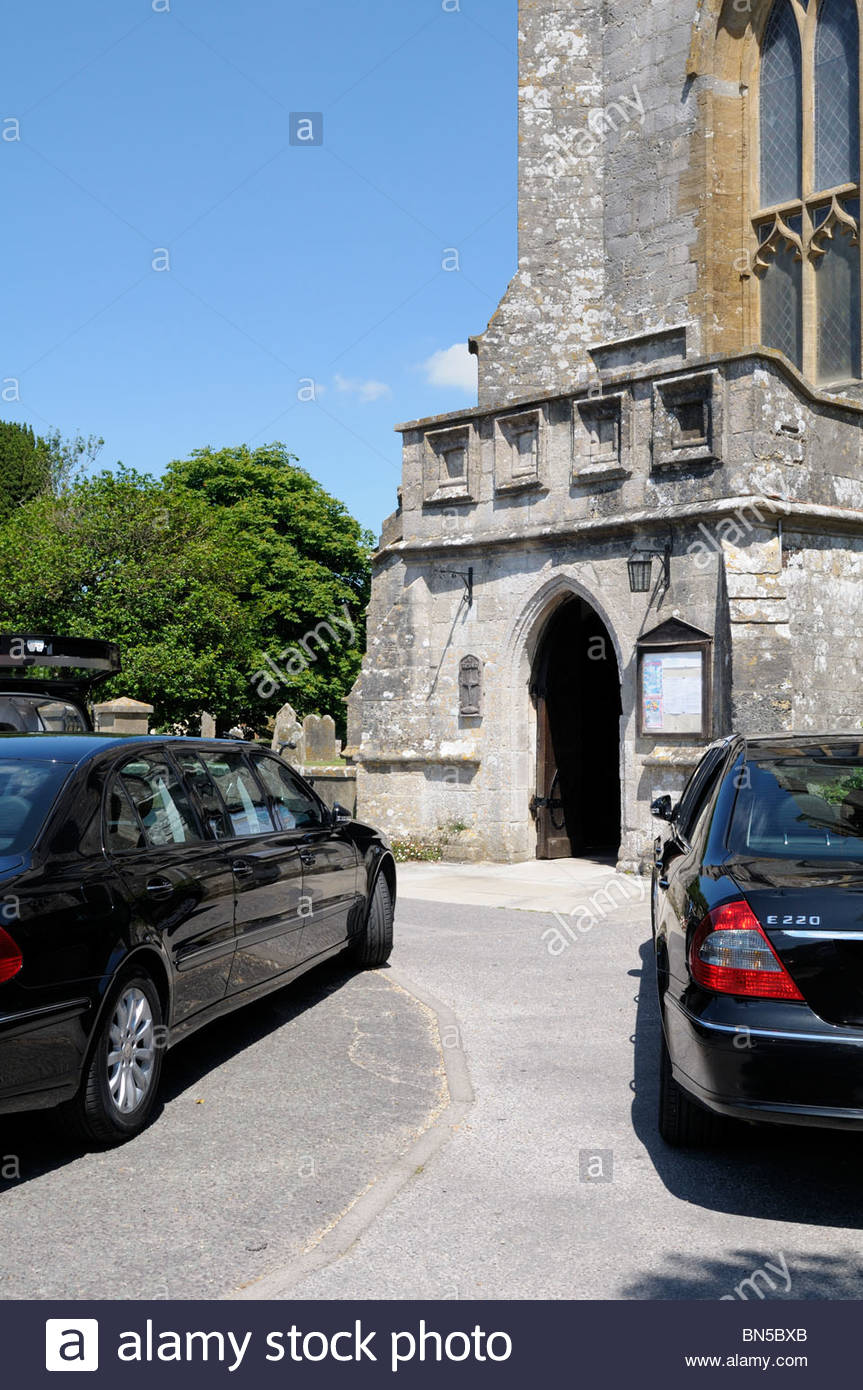 View of cars parked outside  the Church of Lady St. Mary at Wareham, Dorset, England - Stock Image