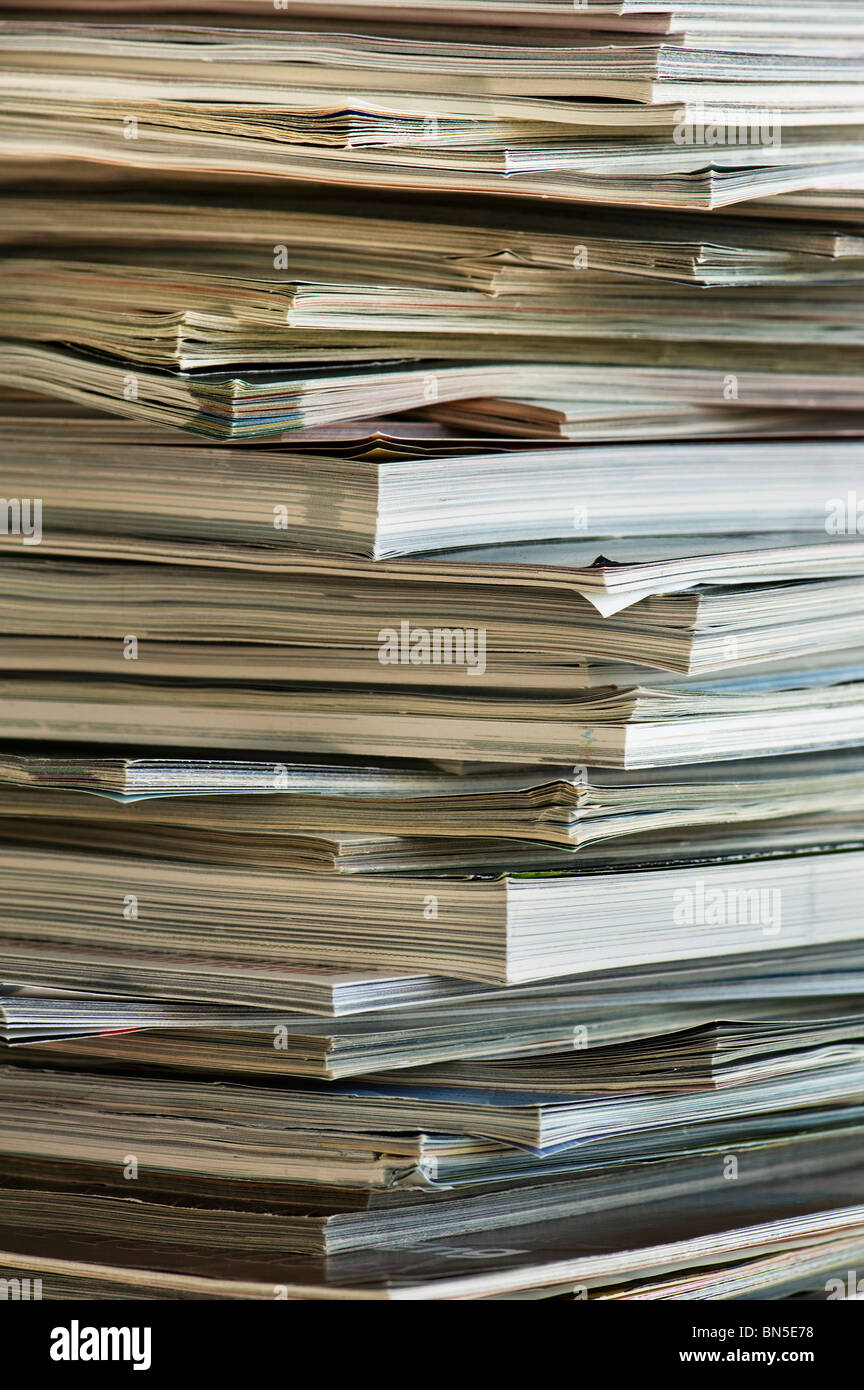 Vertical image of the edges of a stacked pile of magazines. - Stock Image