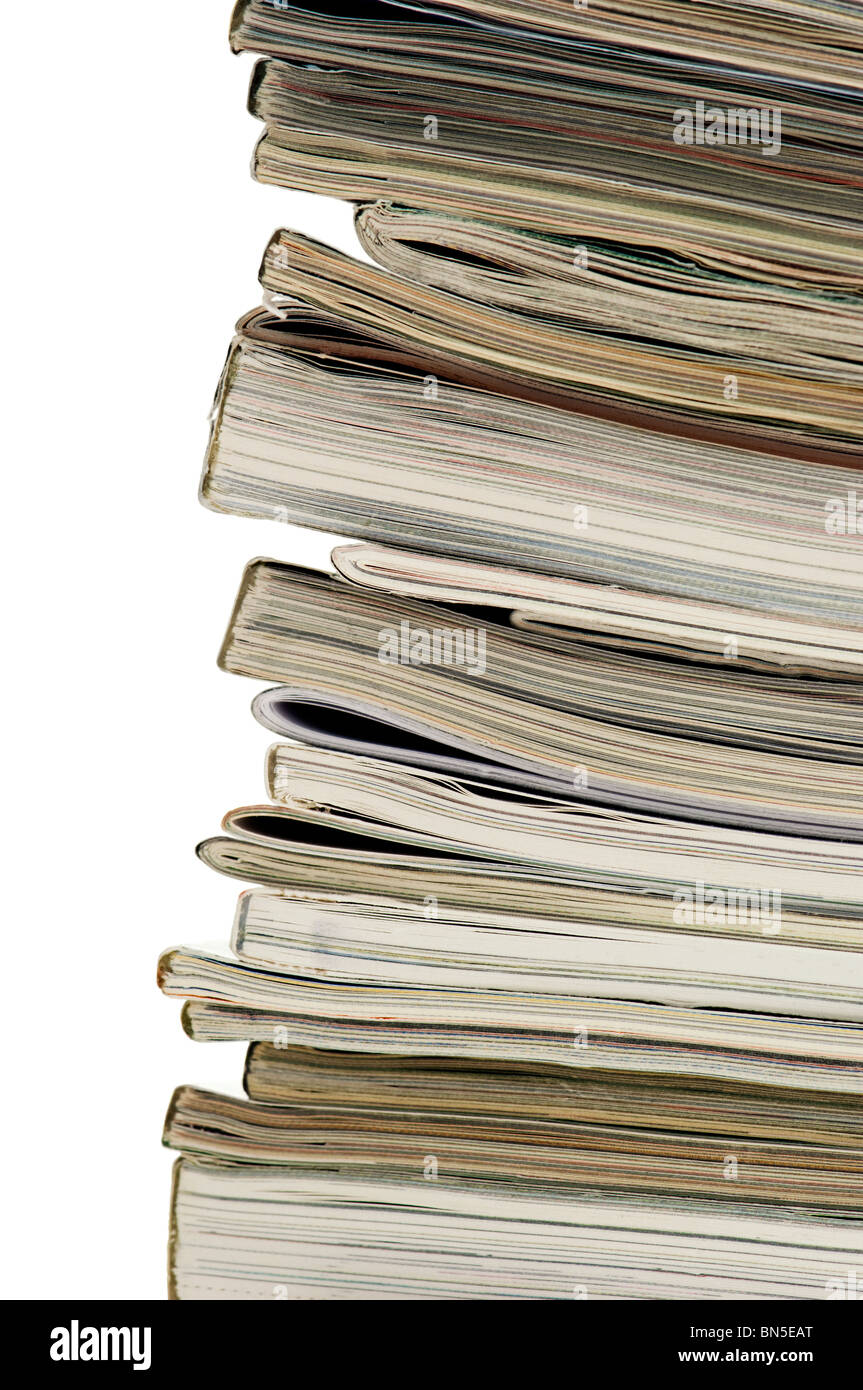 Vertical image of the spine and ends of a stacked pile of magazines. - Stock Image