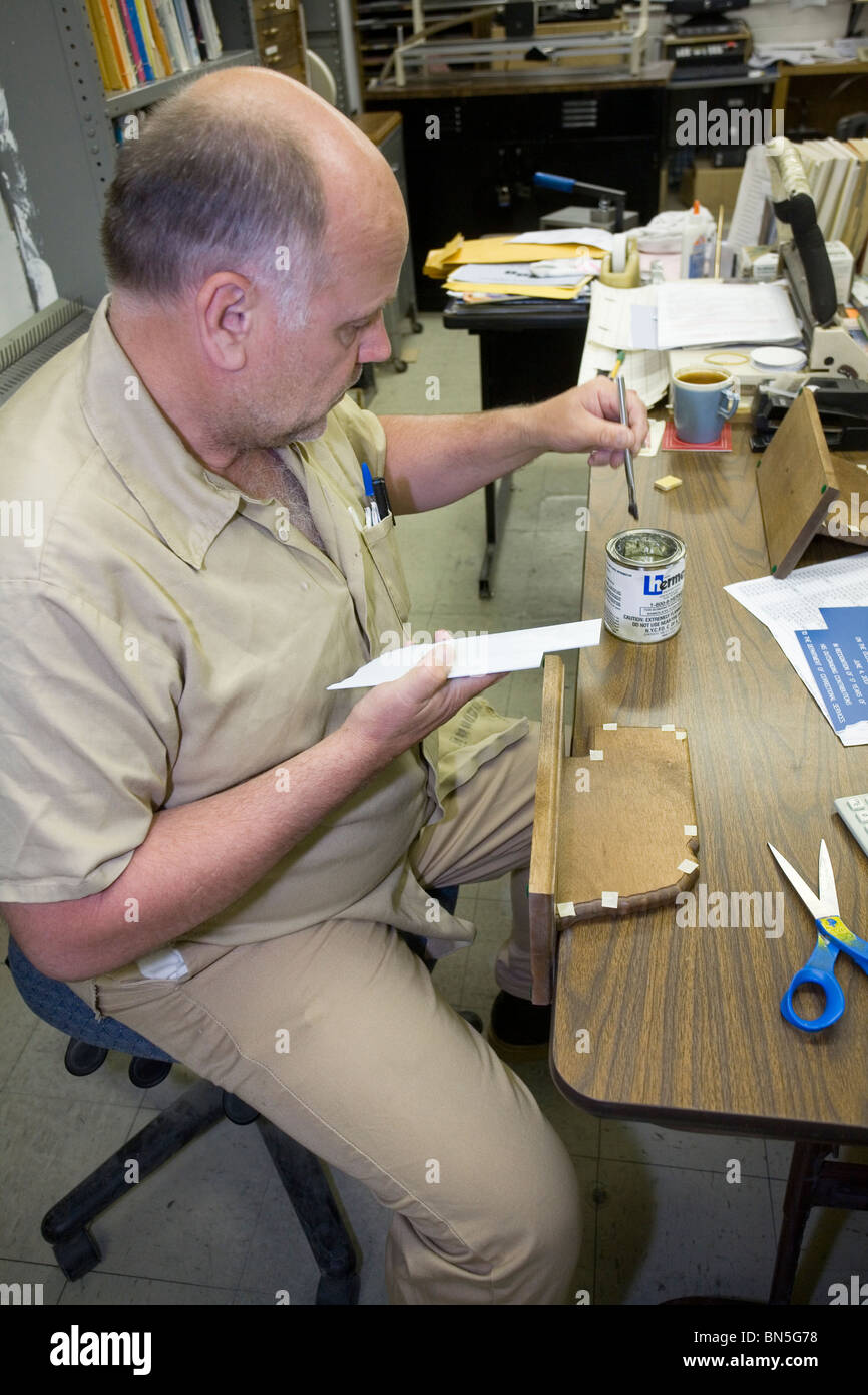 Inmate working making plaques at the Nebraska State Penitentiary. Work programs are important for inmate rehabilitation. - Stock Image