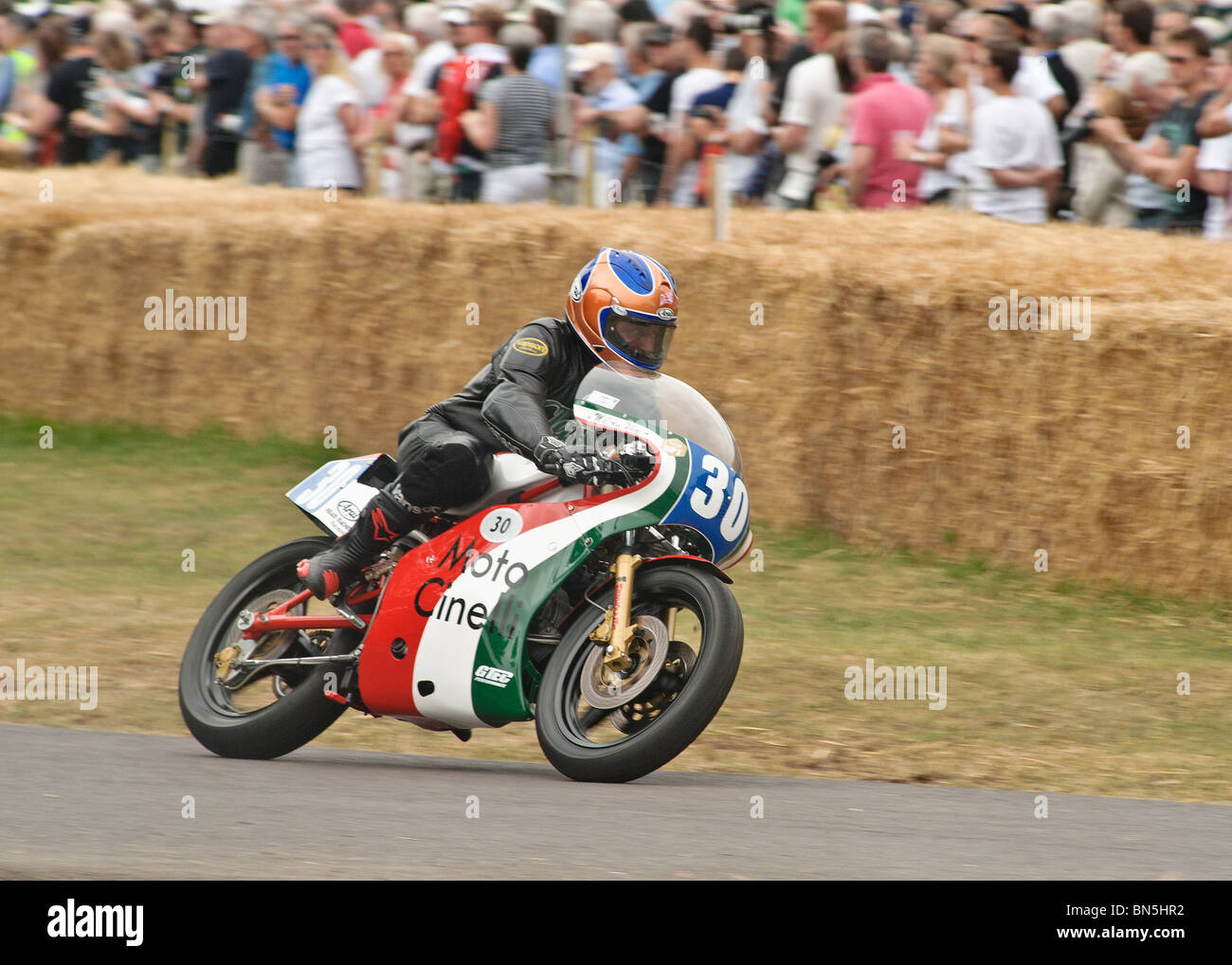 A Motorcycle Climbs The Hill At The Goodwood Festival Of Speed 2010   Stock  Image