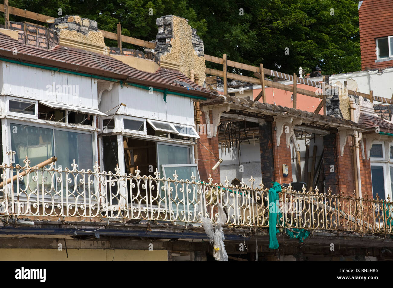 Derelict Edwardian building being demolished on the seafront at Penarth Vale of Glamorgan South Wales UK - Stock Image